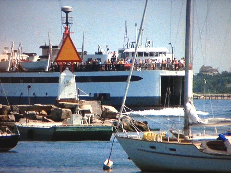 The ferry arrives at Amity Island in Jaws. Can you spot me?